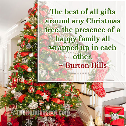 christmas quotation on gifts around christmas tree