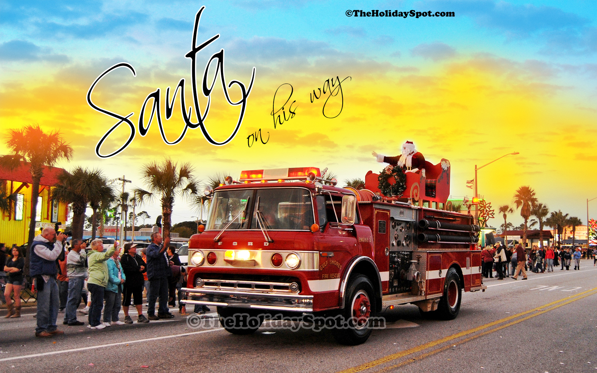 Free christmas wallpapers download hd wallpaper christmas wallpaper of santa coming to town on a firefighter truck voltagebd Images