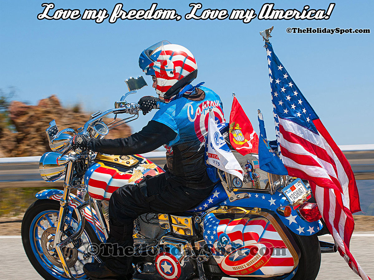 man riding on a bike and proclaiming his love for his country America wallpaper.